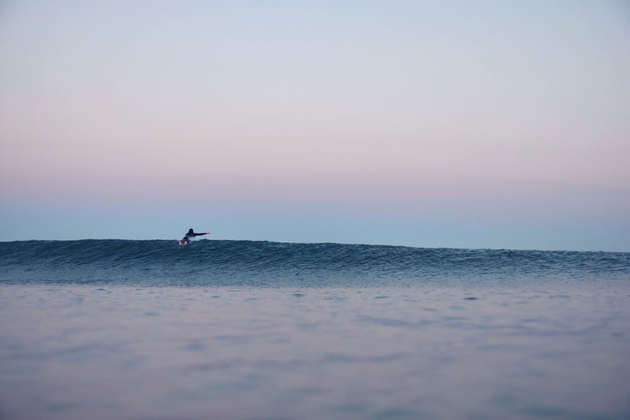 Paddling over a pretty little wave.