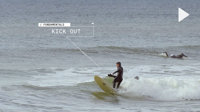 Surfer displaying a good kick out technique