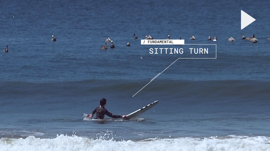 Surfer demonstrating a good sitting turn before a wave